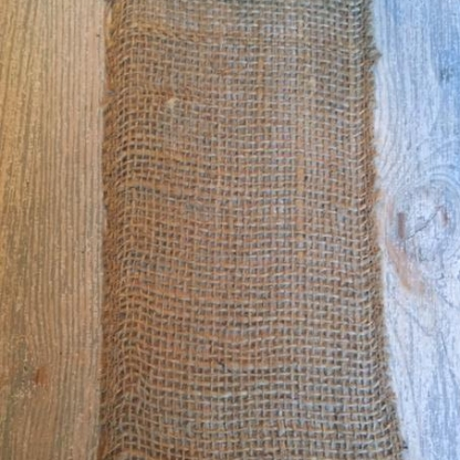 A simple burlap runner can be a great use of texture and provide a neutral base.