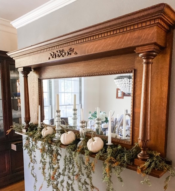 Here is a hanging garland mixed with pumpkins and candles on the mantle.
