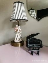 Her vintage lamp and beaded piano